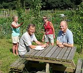 Grindleford Allotment Assoc officials in communal orchard