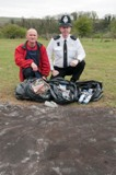Ranger and policeman with litter