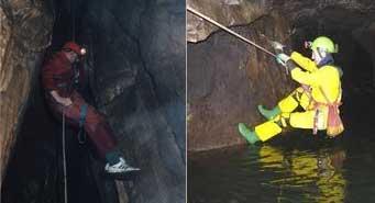man climbing inside a cave