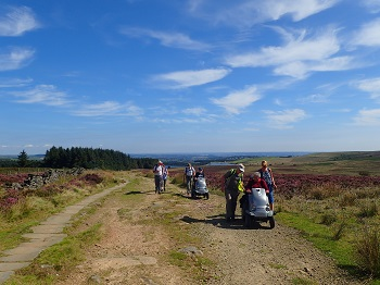 Members of the Disabled Ramblers on Long Causeway from Redmires Reservoir, one of the proposed Miles without Stiles routes in the Peak District National Park