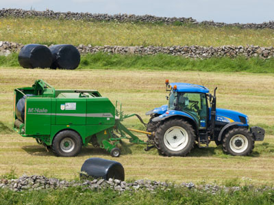 Tractor in field to show farming in protected landscapes