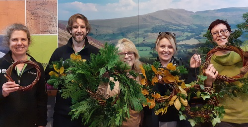 Staff holding a Festive Wreath