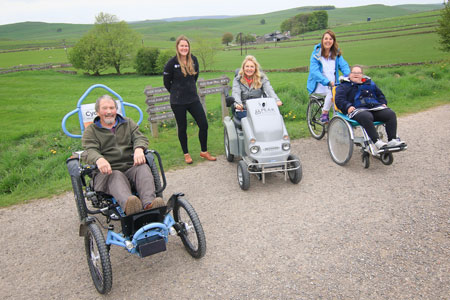 Jane and Gillian try out accessible bikes at Parsley Hay