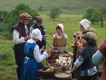 Preparing a meal outdoors on Tudor Day at the Dove Valley Centre